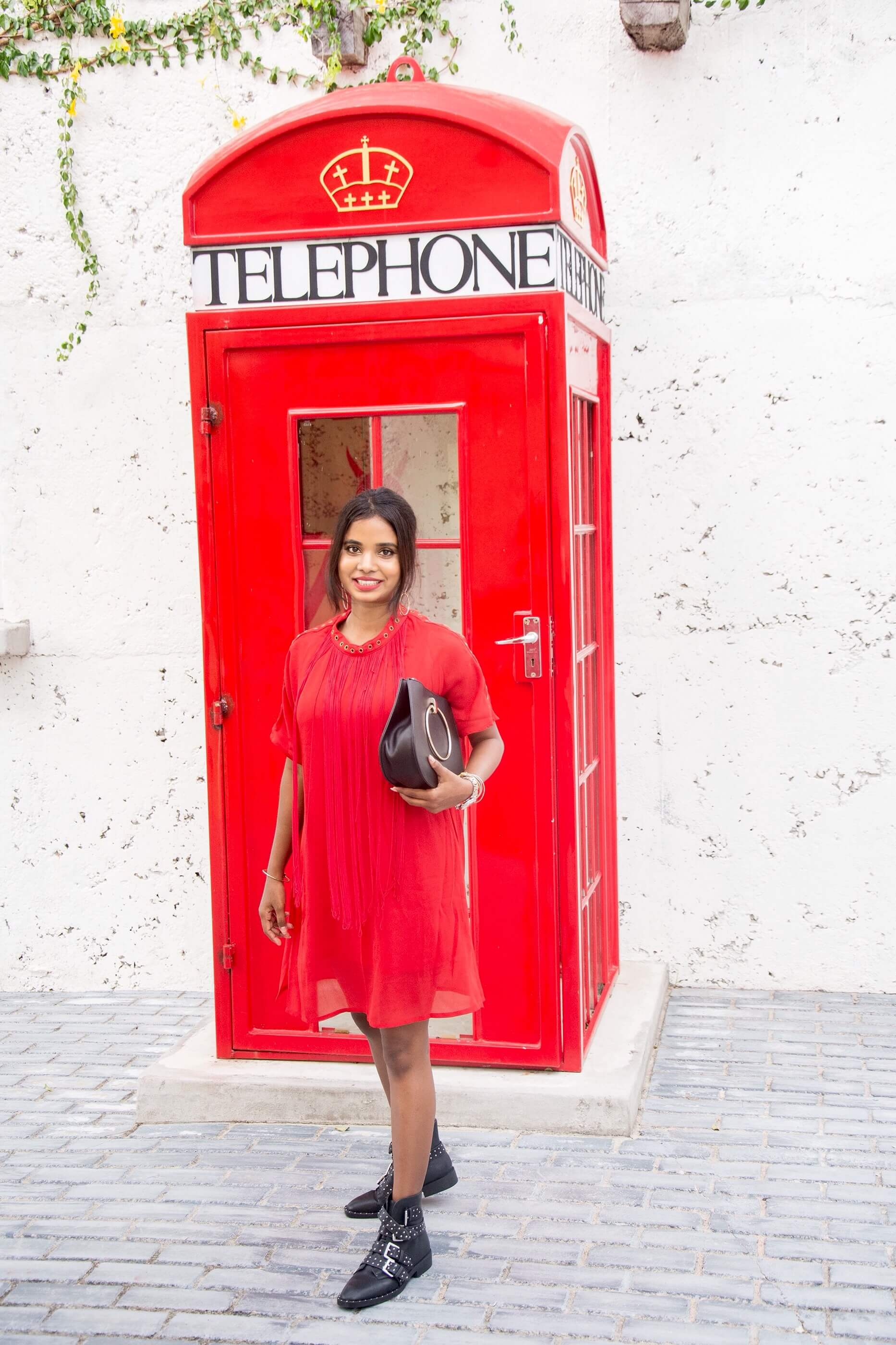 red fringed dress and telephone booth