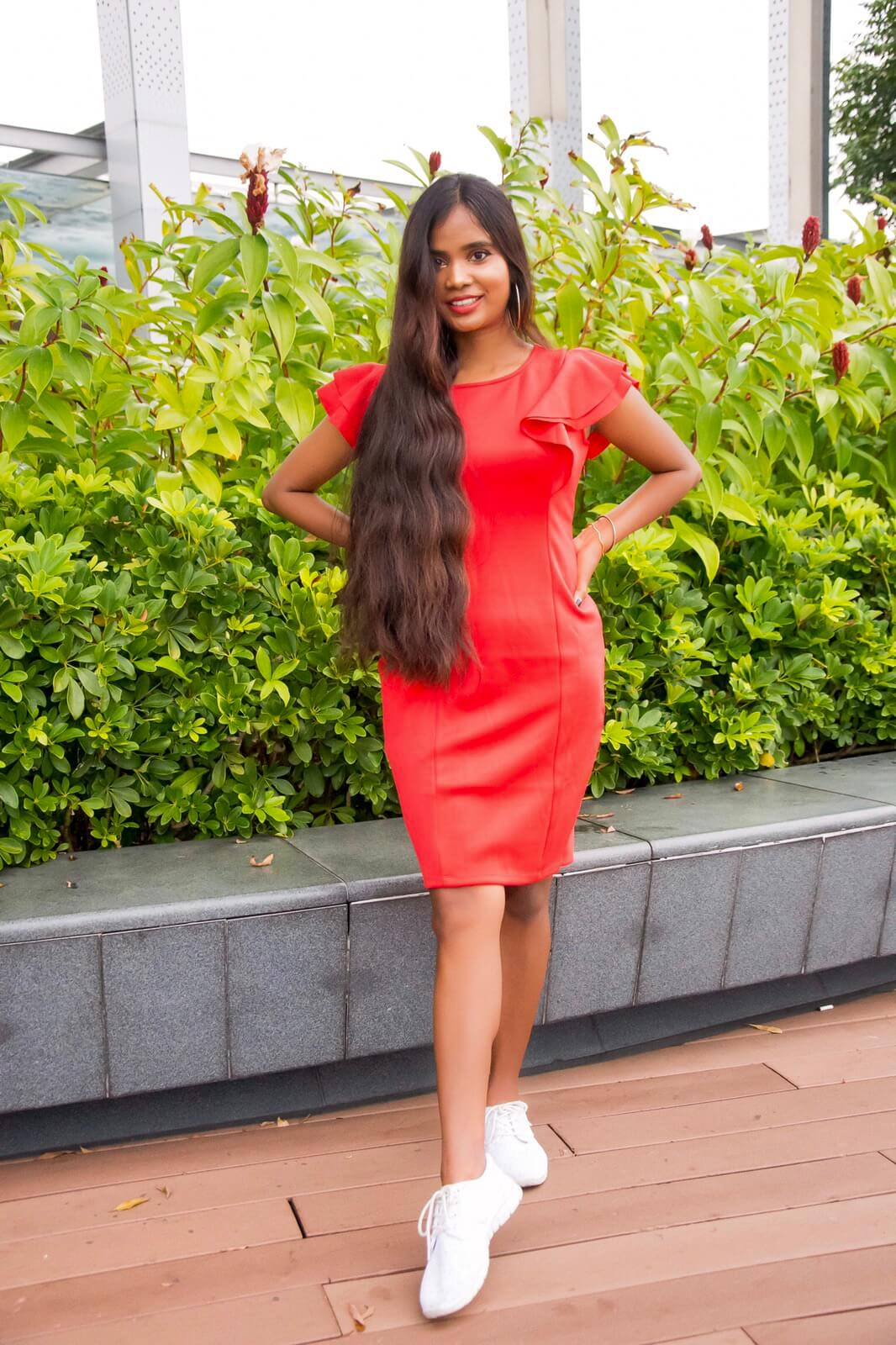 girl with long hair wearing red dress